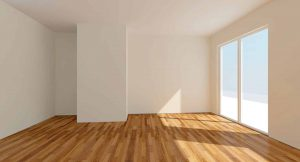 empty sunlit room with white walls