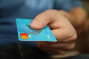 handing over a blue debit caerd