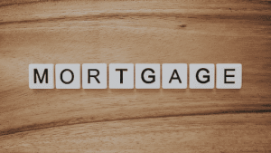 Mortgage spelled out in scrabble letters on a wood surface
