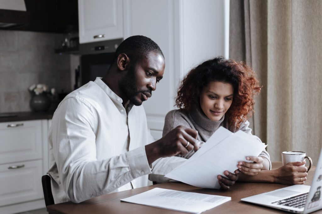 a couple reviewing the housing market