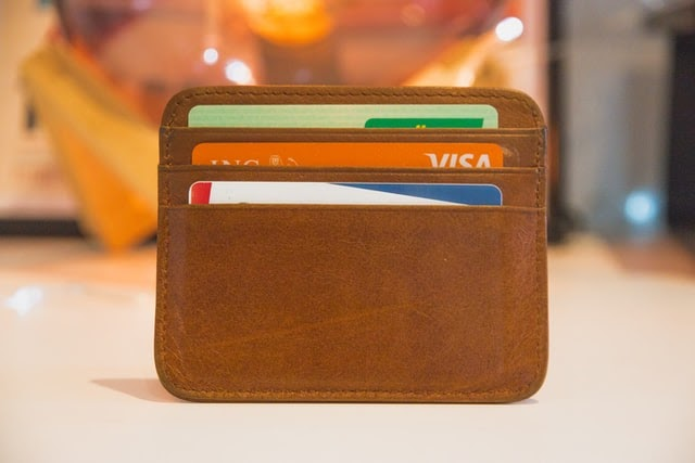 brown wallet with cards