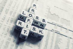 Dice saying profit, loss, risk